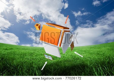 Deconstructed house against green field under blue sky