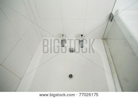 Overhead of white bath tub in the bathroom