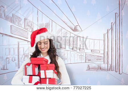 Festive brunette holding pile of gifts against maroon christmas tree pattern