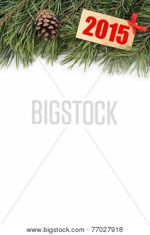 Christmas tree branch and bumps with wooden plate with text