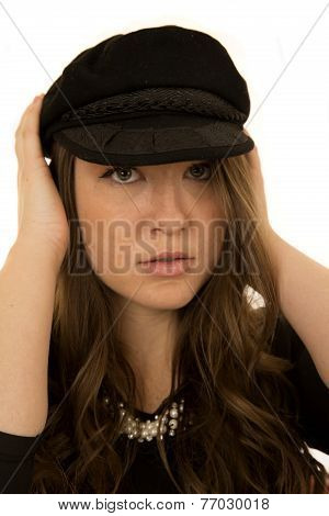 Woman Wearing Black Hat With A Somber Look