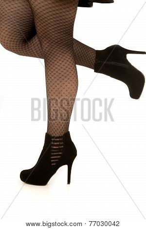 Womans Leg Wearing High Heels One Leg Up