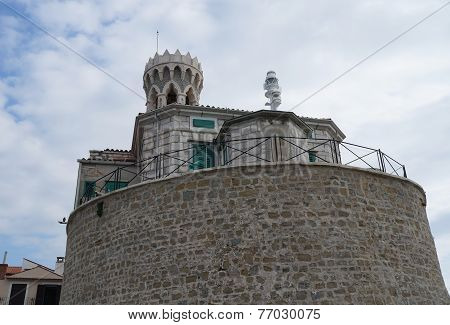 Church of St. Clement and a lighthouse in Piran