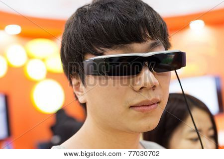 asian young male adult wearing futuristic concept glasses with mutiple function.