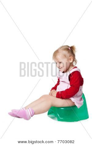 Little Girl Sitting On Potty