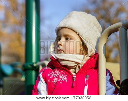Cute Little Girl On Child Playground