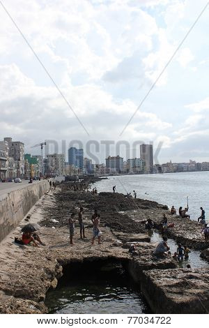 People bathing on Havana Malecon