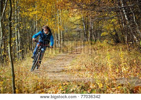 Extreme cyclist autumn
