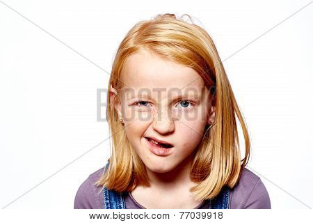 young girl with red hair make grimaces