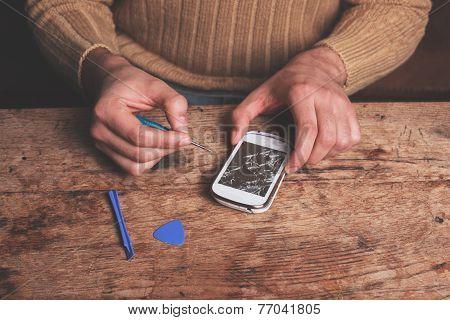 Technician Fixing Smart Phone