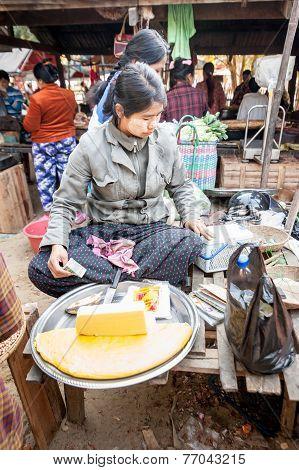 Asian Woman Selling Tofu At Marketplace. Bagan, Myanmar
