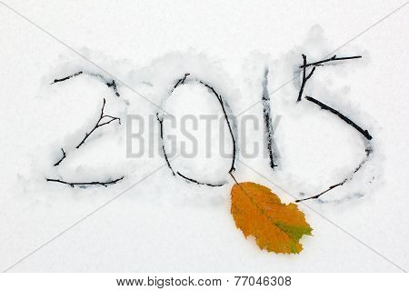 2015 Engraved On The Snow With Branches And Yellow Leaf