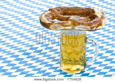Bavarian Oktoberfest pretzel is lying on beer stein (Mass)