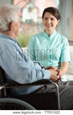 Nurse Visiting Disabled Patient