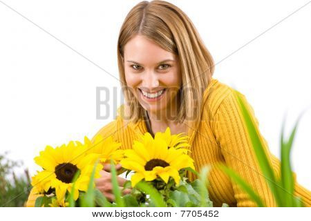 Gardening - Portrait Of Smiling Woman With Sunflowers