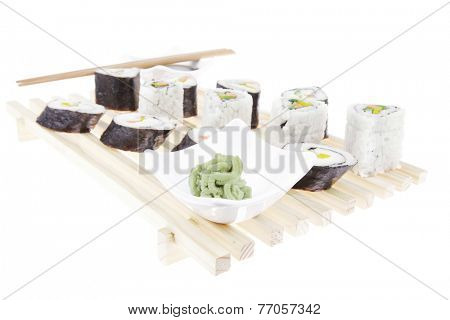 Roll with Cucumber , Cream Cheese with raw Tuna and Salmon inside. on wooden grid . Isolated over white background . Japanese traditional Cuisine