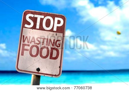 Stop Wasting Food sign with a beach on background