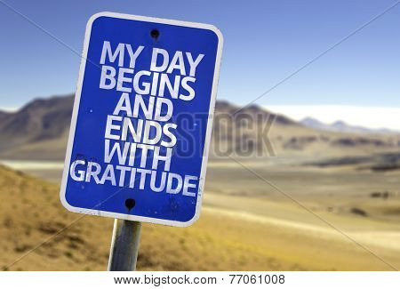 My Day Begins and Ends With Gratitude sign with a desert background