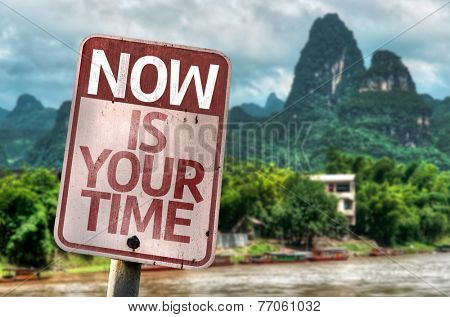 Now Is Your Time sign with a rural background