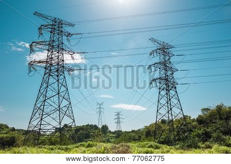 Electricity Pylon Against A Blue Sky
