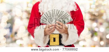 christmas, holidays, winning, currency and people concept - close up of santa claus with dollar money over lights background