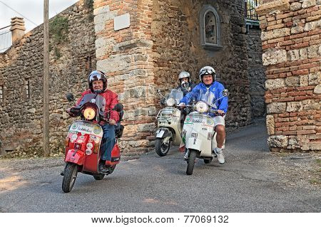 Bikers Riding Italian Scooters