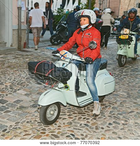 Biker Woman Riding A Vintage Italian Scooter Vespa