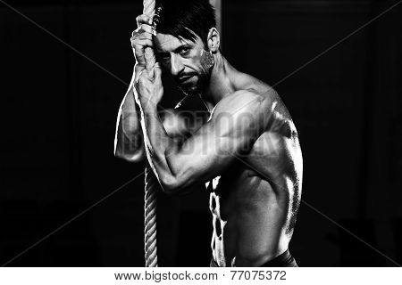 Man Resting After Performing A Rope Climbing