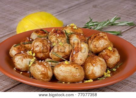 Baked potatoes with lemon zest and rozemary