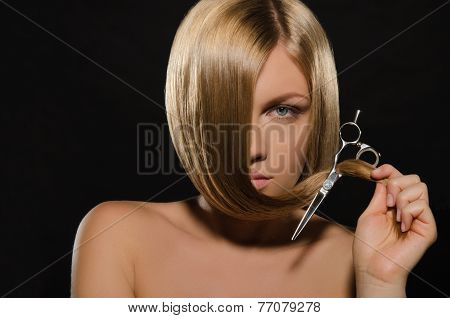 Beautiful Woman With Straight Hair Holds Scissors