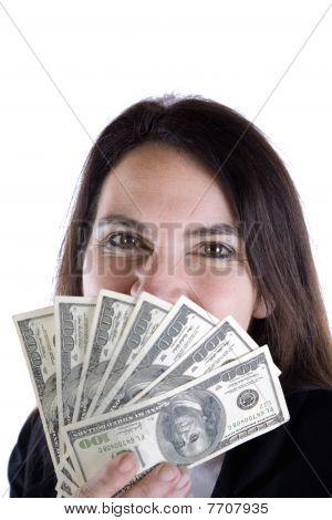 Woman Peeking Over Hundred Dollar Bills.
