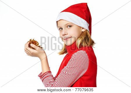 Beautiful Girl In Red Santa Hat With Golden Pine Cones