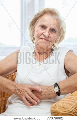 Portrait Of An Elderly Lady Sitting In A Chair