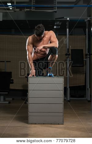 Athlete Resting After Performing A Box Jump