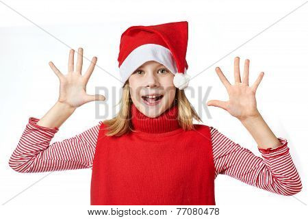 Beautiful Girl In Santa Hat Showing Her Palms Isolated