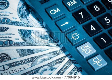 Financial analysis, audit or accounting - Calculator and dollar bills toned in blue