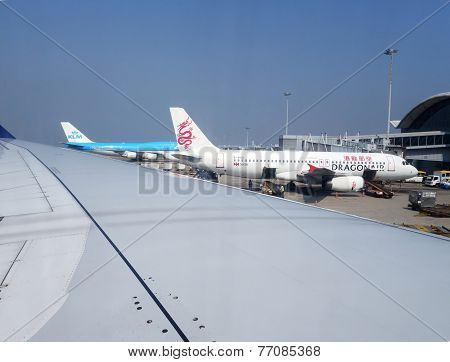 A Dragonair Airplane Is Station In The Hong Kong Airport