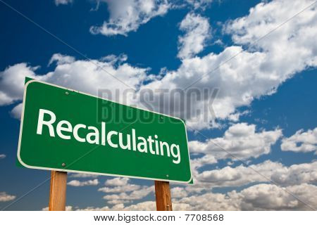 Recalculating Green Road Sign With Sky