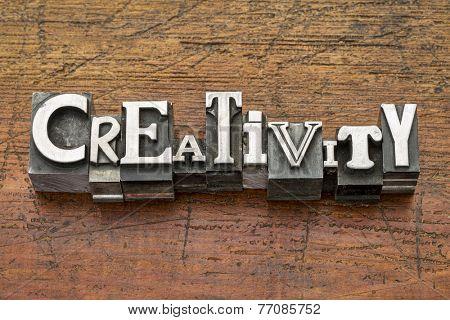 creativity word in mixed vintage metal type printing blocks over grunge wood
