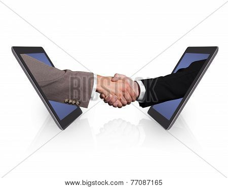 Business Handshake Emerging From Digital Tablets
