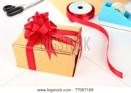 Preparing gift box new year service on desktop.
