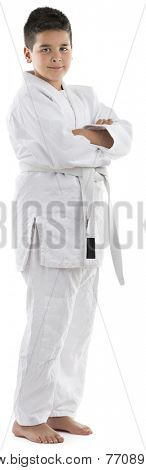 Full length portrait of a judo kid isolated on white background.