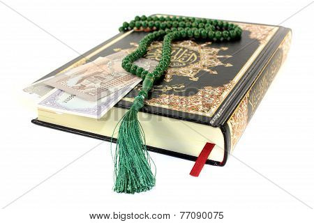 Closed Quran With Pakistani Currency