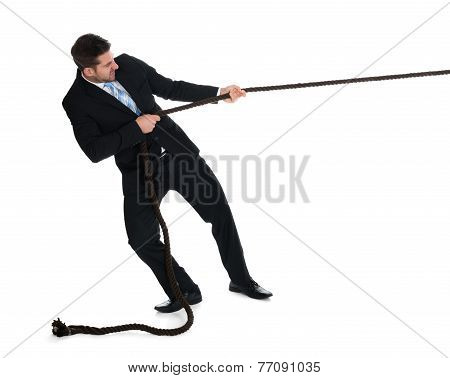 Businessman Pulling Rope Over White Background