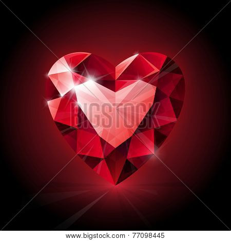 Red shining ruby heart shape on dark background