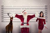 stock photo of mug shot  - Jolly Santa opens his arms to camera against mug shot background - JPG