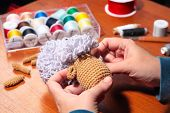 stock photo of thread-making  - Process of making of knitted sheep toy - JPG
