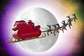 stock photo of bye  - Santa Claus riding a sleigh in dusk led by reindeers passing in front of the moon - JPG