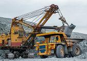 image of asbestos  - Excavator loads ore big dump careers asbestos - JPG