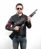 foto of shotgun  - Man in black leather jacket and sunglasses with shotgun - JPG